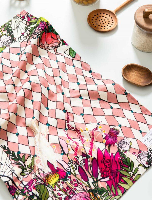 katie cardew pink harlequin tea towel in kitchen
